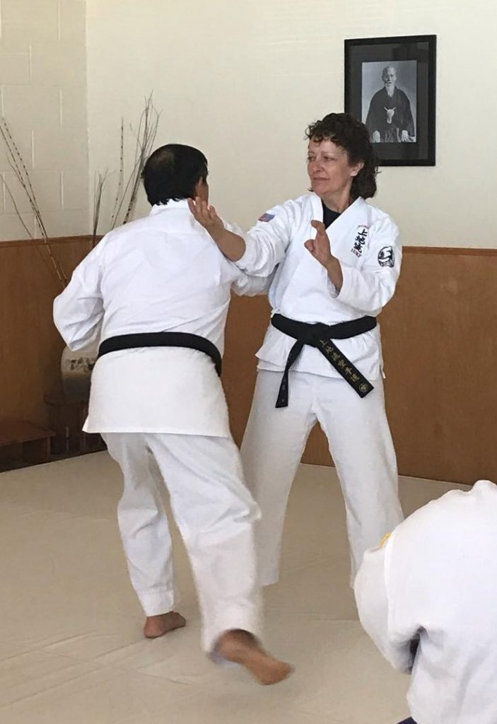 Darin Yee demonstrating an attack with a student.