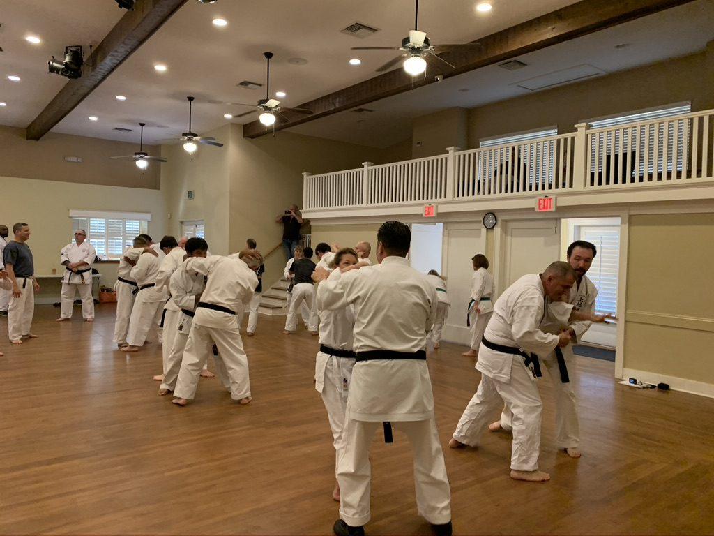 class practicing combat